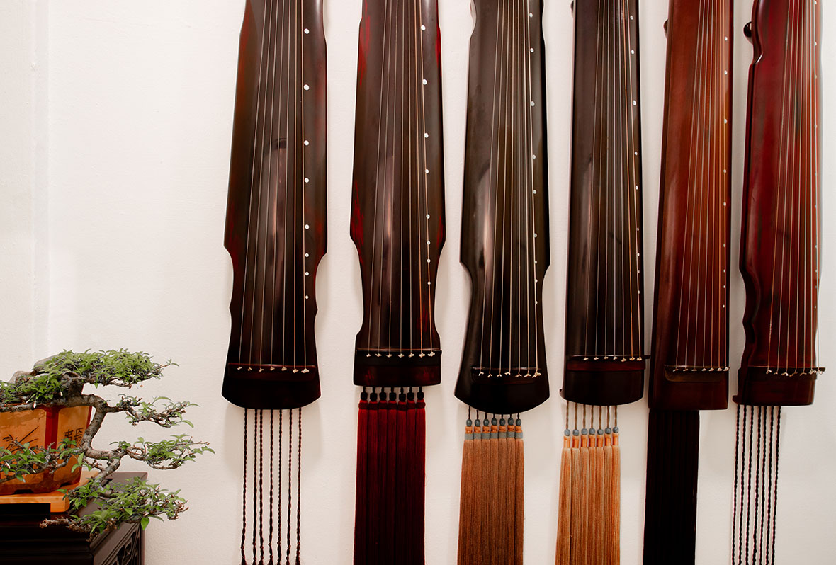 Guqin lined up on Wall